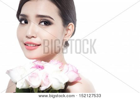 Happy bride with a bouquet of roses. Isolated on white background