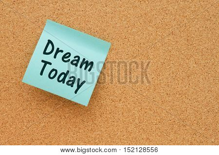 Reminder to Dream Today message Bulletin board with a teal sticky note with text Dream Today
