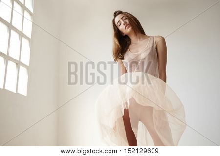 Woman With Blowed Dress By Wind. Sunny Dance Studio