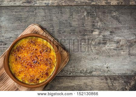 Spanish dessert. Crema catalana on wooden table
