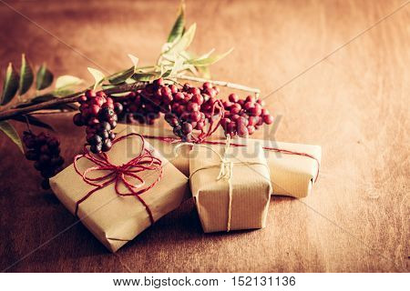Rustic retro gifts, present boxes decoration with cinnamon, dried orange and plants. Christmas time, vintage mood. Handmade eco paper wrap.