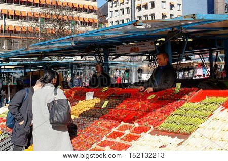 Stockholm, Sweden - March 24, 2016: Close-up of ongoing vegetable and fruit trade at the market square Hotorget