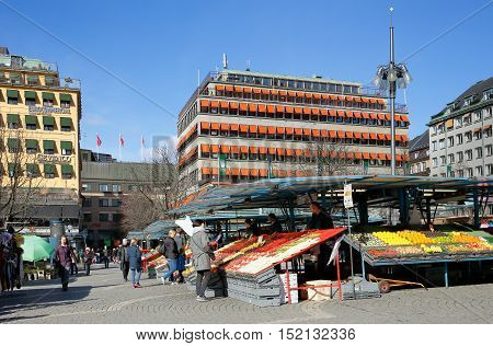 Stockholm, Sweden - March 24, 2016: Ongoing vegetable and fruit trade at the market square Hotorget