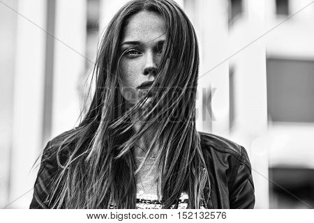 Street fashion concept. Young beautiful model in the city. Beautiful blonde woman close-up portrait of a young sexy girl hipster