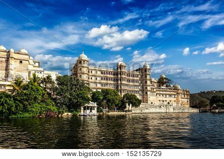 India luxury tourism concept background - Udaipur City Palace from Lake Pichola. Udaipur, Rajasthan, India