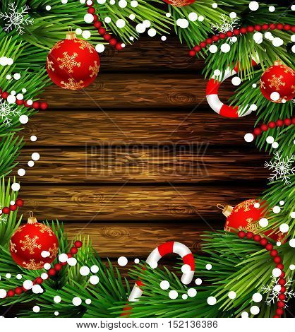 Christmas New Year design wooden background with christmas decorations candy canes snow and balls arranged in a frame in red