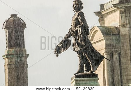 Quebec City, Canada - July 27, 2014: Champlain Monument statue on Dufferin Terrace in sunlight during rain