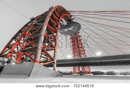 MOSCOW RUSSIA - February 13 2014. Zhivopisny Bridge is cable-stayed red bridge that spans Moscow River in winter