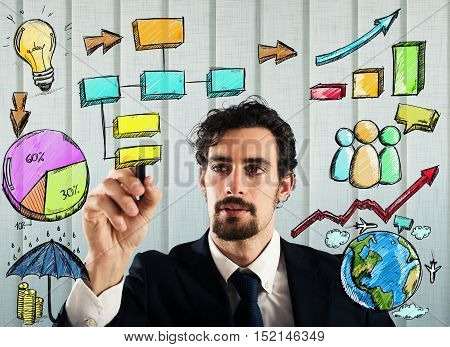 Businessman draws plan and project of business analysis