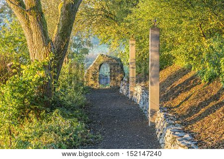 Forest Path With Stone And Stele
