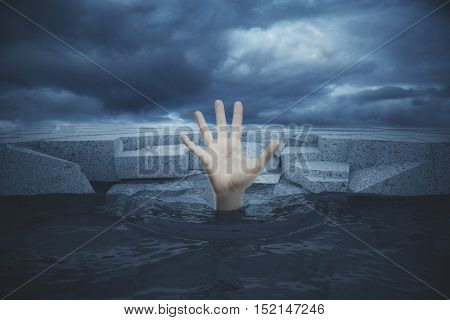 Hand of drawing man in sea seeking rescue on textured concrete blocks and dull sky background. 3D Rendering