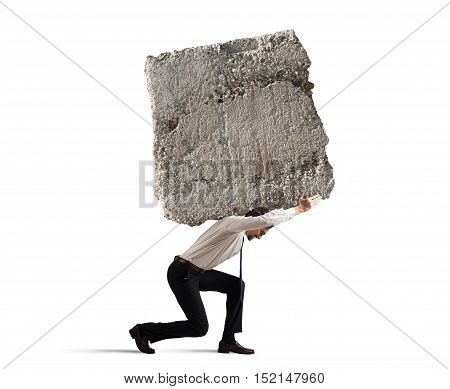 Businessman walking with a heavy boulder on his back