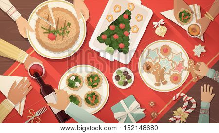 Happy family having Christmas dinner and eating delicious vegan food celebration and holiday banner top view