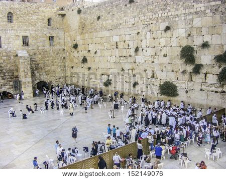 Jerusalem Israel - MAR 27 2008: Jewish worshipers gather for a Bar Mitzvah ritual at the Western wall in Jerusalem.