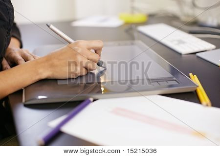 Woman Drawing Sketches On Computer In Fashion Design Studio