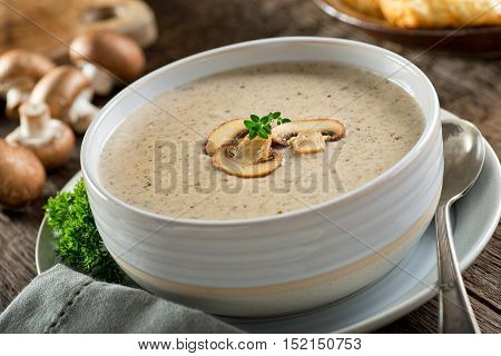 A bowl of delicious homemade cream of mushroom soup.