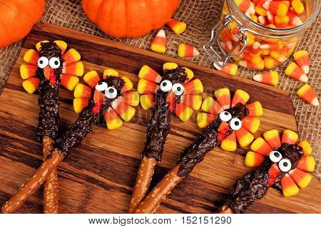Thanksgiving Turkey Pretzel Sticks With Candy Corn, Above View On Wood