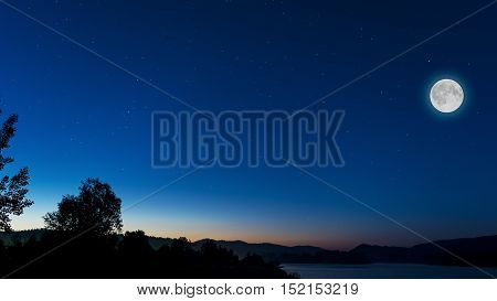 Midnight sky with full moon above river landscape. Full moon on the night sky. Full mystic Moon. Moon and star on night sky.