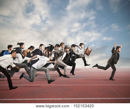 Businessman exults winning during a race with opponents