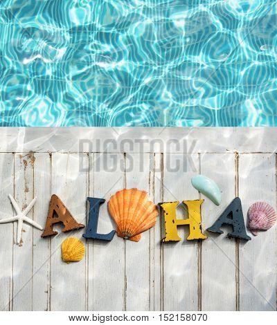 Aloha Text Swimming Pool Water Shells Concept