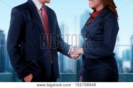 Business Man And Woman Get Deal With Shaking Hand