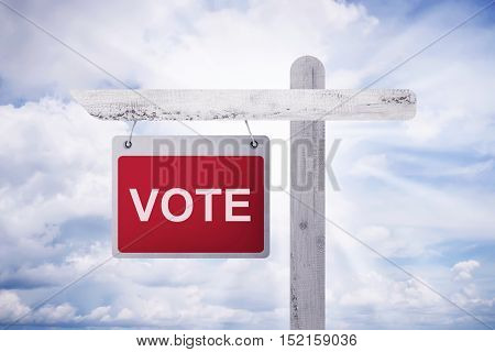 Written 'vote' On A Red Background Hanging On A Wooden Pole