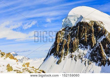Breithorn with group of ski alpinist on the top viewed from Klein Matterhorn on a clear winter day.