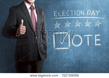 Man With Business Suit Standing Beside 'election Day'