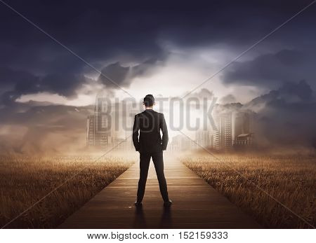 Young Asian Businessman Walking To Modern City