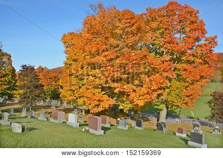 IRON HILL QUEBEC CANADA 10 07 2016: Holy Trinity cemetery. This cemetery is found beside the Holy Trinity Church, in the churchyard, which is in the a small and pretty town of Iron Hill