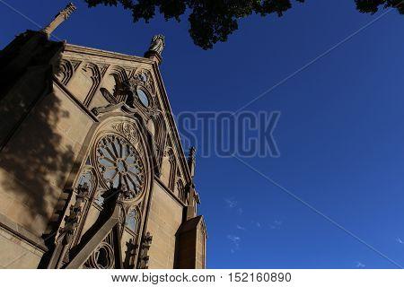 San Felipe del Neri catholic church under shade of tree