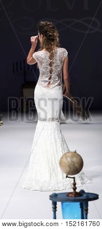 New York NY USA - October 8 2016: A model walks runway for Olvi's by Olga Yermoloff Spring 2017 Collection 'Alchemy' during New York International Bridal Week at the Fashion Theater Pier 94 Manhattan