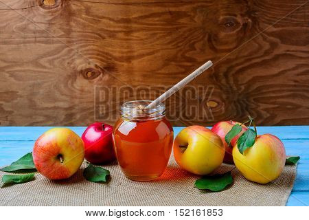Healthy eating concept with glass honey jar and fresh apples copy space. Jewish new year symbols.