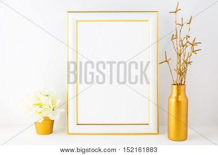 Frame mockup with ivory hydrangea in the golden flower pot. Poster white frame mockup. Empty white frame mockup for presentation artwork.