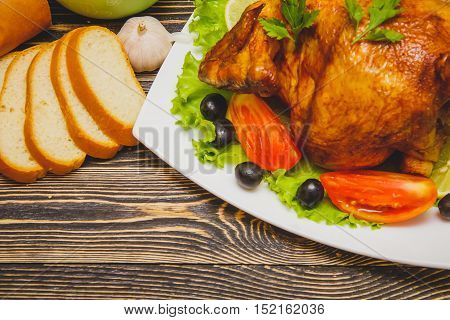 Homemade Roasted Thanksgiving Day Turkey on Wooden Table with Copy Space