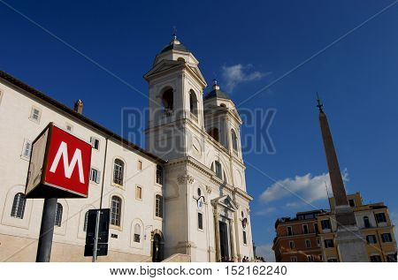 ROME, ITALY - SEPTEMBER 30: The famous Spanish Steps with subway station sign SEPTEMBER 30, 2016 in Rome, Italy
