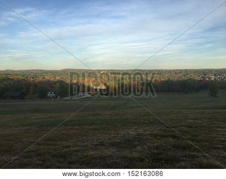 grass field view of fall foliage with sky