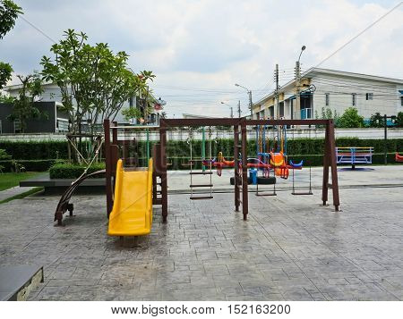 Slide and swings in a children's playground
