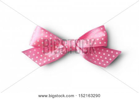 Beautiful pink bow with polka dot pattern on white background