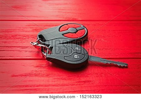 Car key on red table