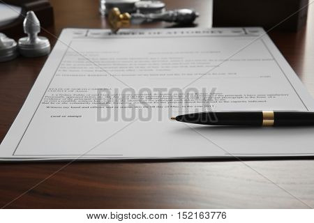 Pen and document on notary public table