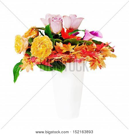 Floral bouquet arrangement centerpiece in white vase isolated on white background.