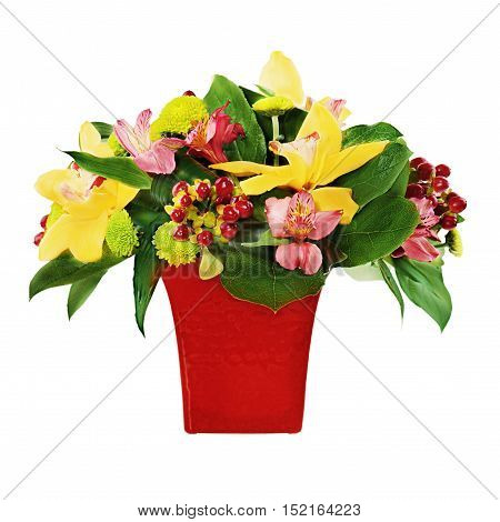 Colorful flower bouquet from orchids and lilies arrangement centerpiece in red vase isolated on white background.