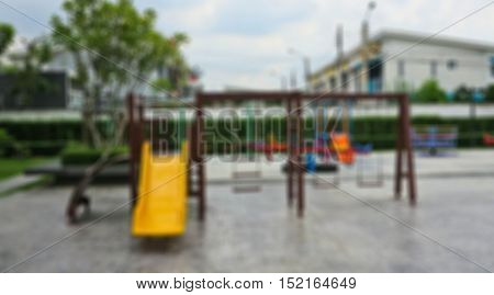 Abstract blur slide and swings in a children's playground
