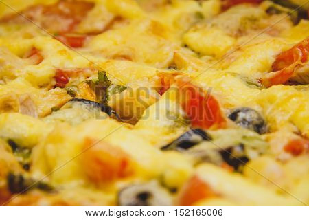Homemade rectangular pizza with ingredients close up