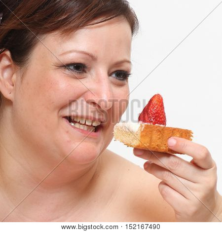 Overweight woman eating sweet cream cake. Obese people enjoying life. Healthy lifestyle theme.