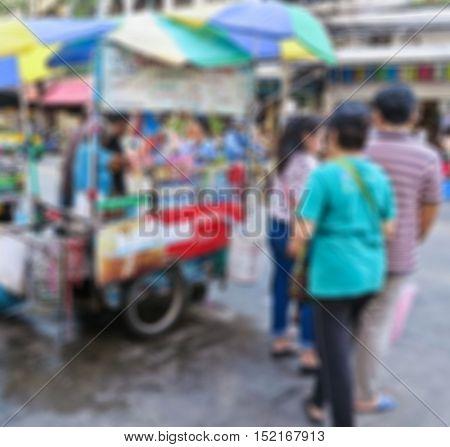 Abstract blur coffee cart stall on street at sampeng market