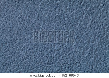 Navy blue fluffy background of soft fleecy cloth. Texture of textile closeup.