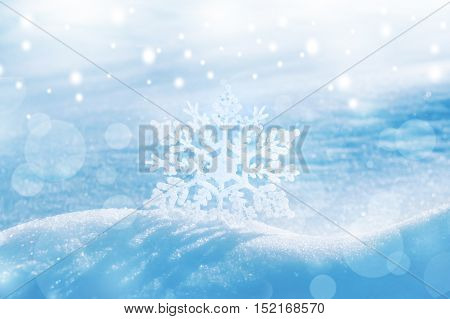 Christmas background with decorative snowflake on brilliant snow
