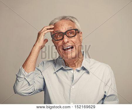 Thinking elderly man.
